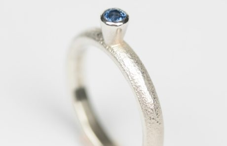Silver ring with a blue stone