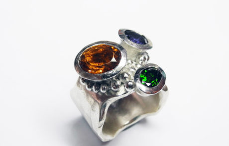 Silver ring with amber, blue and green stones