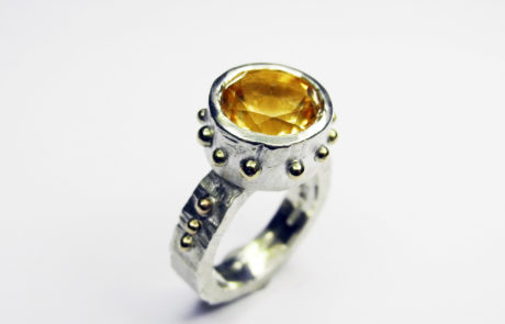 Silver ring with an amber stone